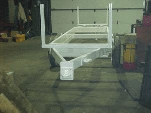 Light weight double ended pipe hauling trailer