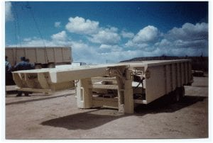 Bulk rock dust trailer showing controls on front corner