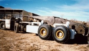 A fifth wheel shield hauler trailer with shield loaded