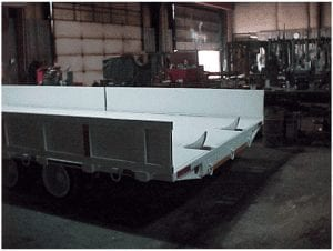 Rear of roof can trailer showing chock arms and sideboards