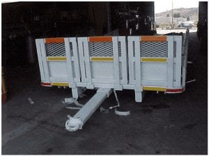 Supply trailer with retractable tongue and removable sideboards
