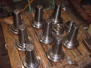 Heavy duty wheel spindles built for mining applications