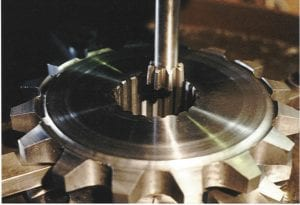 Cutting internal splines in the bore of a double row sprocket