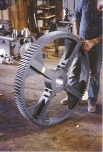 A spur gear made in two halves